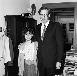 "[""Senator John D. (Jay) Rockefeller stands next to a young woman wearing a visitor's badge.""]%"