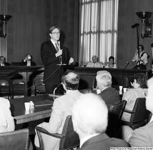 "[""Senator John D. (Jay) Rockefeller speaks to the audience in a Senate committee room.""]%"