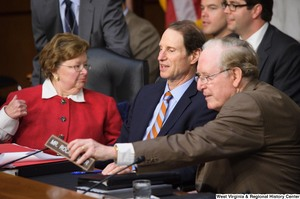 "[""Senators John D. (Jay) Rockefeller, Ron Wyden, and Barbara Mikulski talk during the nomination hearing for General David Petraeus as the new Director of the Central Intelligence Agency.""]%"
