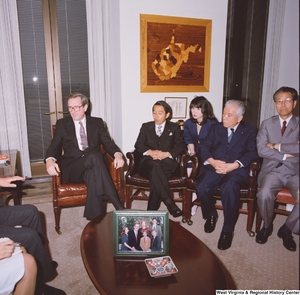 "[""Senator John D. (Jay) Rockefeller sits in his office with a delegation from the Japanese Embassy.""]%"