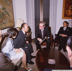 "[""Senator John D. (Jay) Rockefeller speaks with members of a Japanese Embassy delegation in his office.""]%"