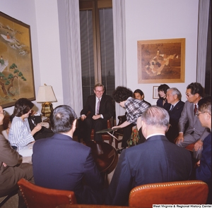 "[""Senator John D. (Jay) Rockefeller sits with members of a delegation from the Japanese Embassy.""]%"