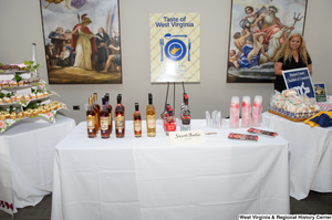 "[""This photograph shows a table with Smooth Amber liquors as part of the 150th birthday celebration for West Virginia on Capitol Hill.""]%"