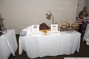"[""Flying W Farms displays some of their beef at the 150th birthday celebration for West Virginia.""]%"