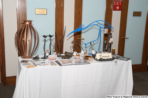 "[""Artwork from Tamarack is displayed at the 150th birthday celebration for West Virginia.""]%"