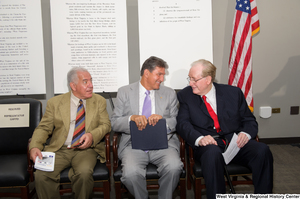 "[""Senators John D. (Jay) Rockefeller and Joe Manchin sit with Representative Rahall at the 150th birthday celebration for West Virginia.""]%"
