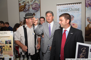 "[""Senator Joe Manchin raises a sample of a West Virginia liquor.""]%"