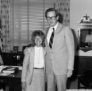 "[""Senator Rockefeller poses for a photograph and embraces an unidentified guest in his Washington office.""]%"