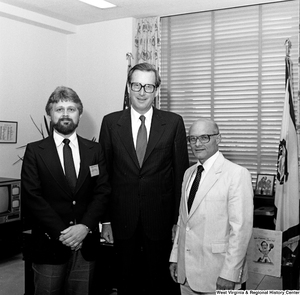 "[""Senator John D. (Jay) Rockefeller poses for a photograph with Jack Frazier and Bernard Kern in his Washington office.""]%"