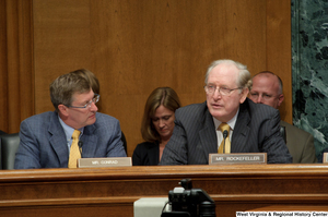 "[""Senators John D. (Jay) Rockefeller and Kent Conrad sit at a Finance Committee hearing.""]%"