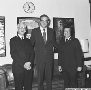 "[""Senator John D. (Jay) Rockefeller smiles and stands for a photograph with Major Cooper and Major Jaynes of the Salvation Army.""]%"