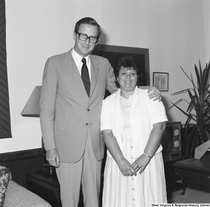 "[""Senator John D. (Jay) Rockefeller stands for a photograph with an unidentified woman from West Virginia in his Washington office.""]%"