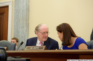 "[""Senators John D. (Jay) Rockefeller and Kelly Ayotte speak during a Commerce Committee hearing.""]%"