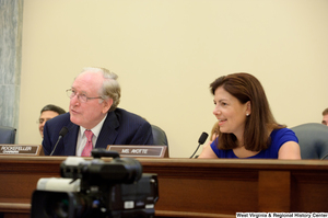 "[""Chairman John D. (Jay) Rockefeller and Senator Kelly Ayotte speak at a Commerce Committee hearing.""]%"