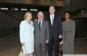 "[""Senator John D. (Jay) Rockefeller and Sharon Rockefeller stand with two unidentified individuals.""]%"