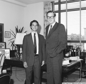 "[""Senator John D. (Jay) Rockefeller stands in his Dirksen office for a photograph with an unidentified individual.""]%"