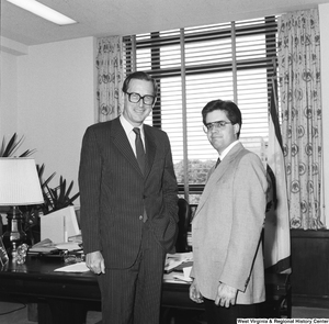 "[""Senator John D. (Jay) Rockefeller stands for a photograph with an unidentified man in his Washington office.""]%"