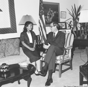 "[""Senator John D. (Jay) Rockefeller sits in a chair and speaks with an unidentified guest in his office.""]%"