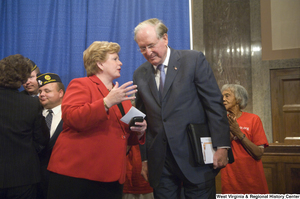 "[""Senator John D. (Jay) Rockefeller and Senator Debbie Stabenow talk after a Standing Together for Medicaid press event.""]%"