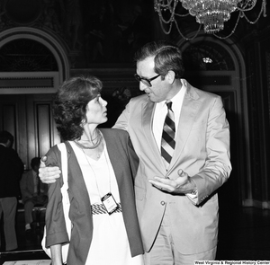 "[""Senator John D. (Jay) Rockefeller chats with an unidentified representative from NASA Headquarters outside the Senate.""]%"