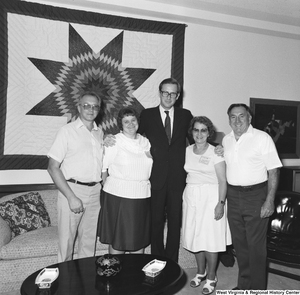 "[""Senator john D. (Jay) Rockefeller stands for a photograph with four unidentified individuals in his Washington office.""]%"