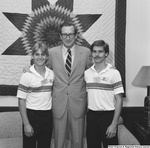 "[""Two Boys Nation participants from West Virginia stand for a photograph with Senator John D. (Jay) Rockefeller in his Washington office. Boys Nation is educational civic simulation program sponsored annually by the American Legion.""]%"