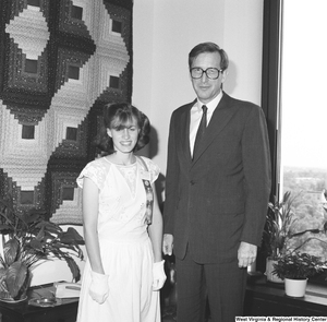 "[""Senator John D. (Jay) Rockefeller stands next to one of the West Virginia participants in Girls Nation.""]%"