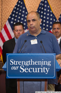 "[""A visitor speaks at a Strengthening our Security press event.""]%"
