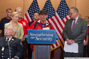 "[""An unidentified man speaks at a Strengthening our Security event.""]%"