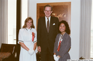 "[""Senator John D. (Jay) Rockefeller stands with two Girls Nation participants.""]%"