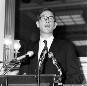 "[""Close up of Senator John D. (Jay) Rockefeller speaking at a press event in a Senate building.""]%"