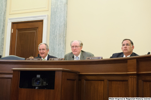 "[""Chairman John D. (Jay) Rockefeller sits between Senators Tom Harkin and John Boozman and at a Commerce Committee hearing.""]%"