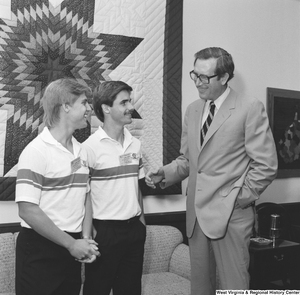 "[""Senator John D. (Jay) Rockefeller speaks with two Boys Nation participants from West Virginia. Boys Nation is a civic and political simulation for top high school boys from each state and is run annually by the American Legion.""]%"