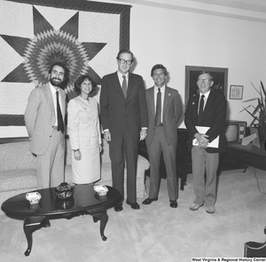 "[""Senator John D. (Jay) Rockefeller stands for a photograph with an unidentified group in his Washington office.""]%"