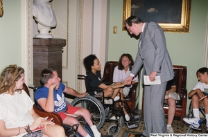 "[""Senator John D. (Jay) Rockefeller shakes hands with a member of the Center for Independent Living from Huntington, West Virginia.""]%"
