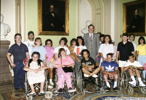 "[""Senator John D. (Jay) Rockefeller stands with members of the Center for Independent Living.""]%"