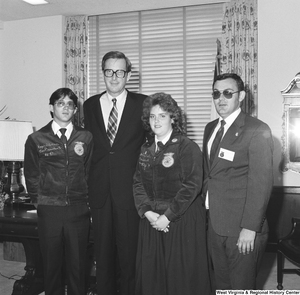 "[""Senator John D. (Jay) Rockefeller stands for a photograph in his office with three representatives from Future Farmers of America.""]%"