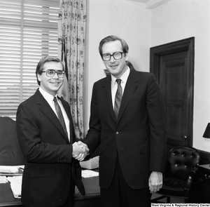 "[""Senator John D. (Jay) Rockefeller and an unidentified guest shake hands in his Washington office.""]%"