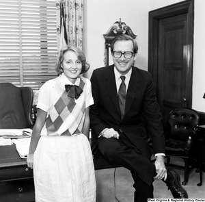 "[""Senator John D. (Jay) Rockefeller and an unidentified woman smile and pose for a photograph in the Senator's Washington office.""]%"