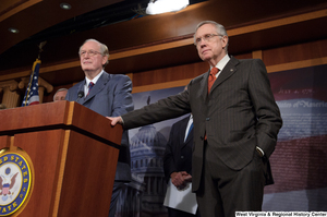 "[""Senators John D. (Jay) Rockefeller and Harry Reid speak at a Commerce Committee press event.""]%"