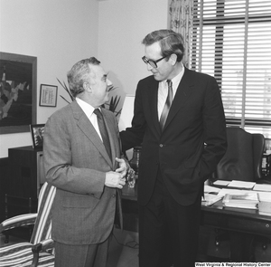 "[""Senator John D. (Jay) Rockefeller speaks with an unidentified individual in his Senate office.""]%"