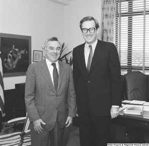 "[""Senator Rockefeller stands for a photograph with an unidentified man in his office.""]%"
