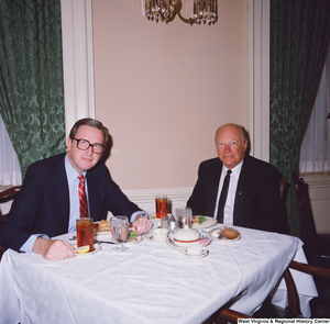 "[""Senator John D. (Jay) Rockefeller and an unidentified individual dine together.""]%"