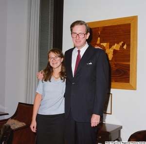 "[""Senator John D. (Jay) Rockefeller with an unidentified young woman in his office.""]%"