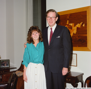 "[""Senator John D. (Jay) Rockefeller and an unidentified young woman in his Washington office.""]%"