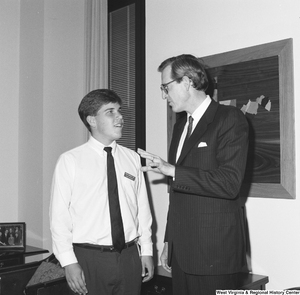 "[""Senator John D. (Jay) Rockefeller talks with a Senate Democratic Page.""]%"