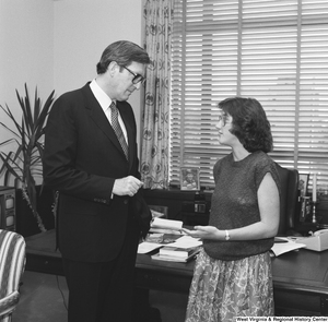 "[""An unidentified woman speaks with Senator John D. (Jay) Rockefeller in his Washington office.""]%"