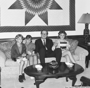 "[""Three young and unidentified students sit on a couch with Senator John D. (Jay) Rockefeller in his Washington office.""]%"