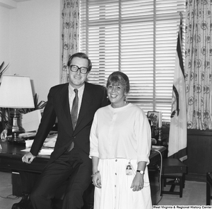 "[""Senator John D. (Jay) Rockefeller poses for a photograph with an unidentified woman in his office.""]%"