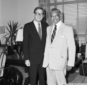 "[""Senator John D. (Jay) Rockefeller stands for a photograph with an unidentified individual.""]%"